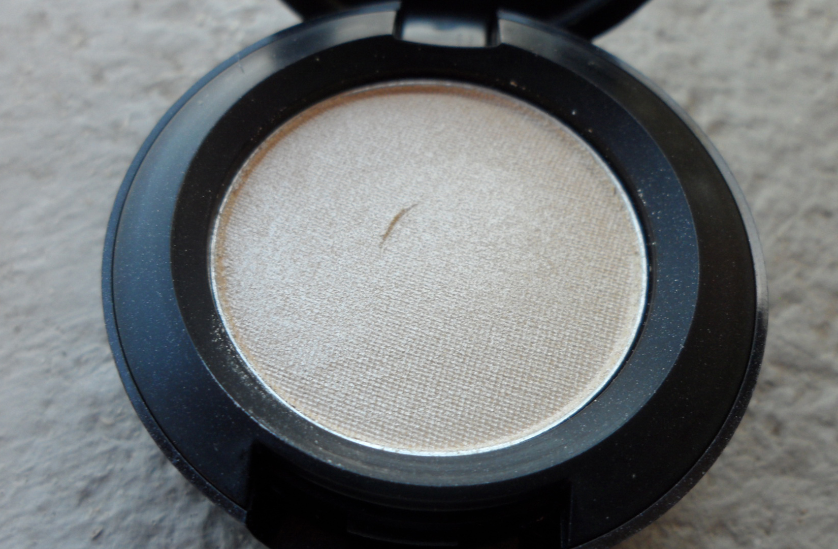 MAC Nylon looks like a pale yellow cold in the pan. it looks very subtle.