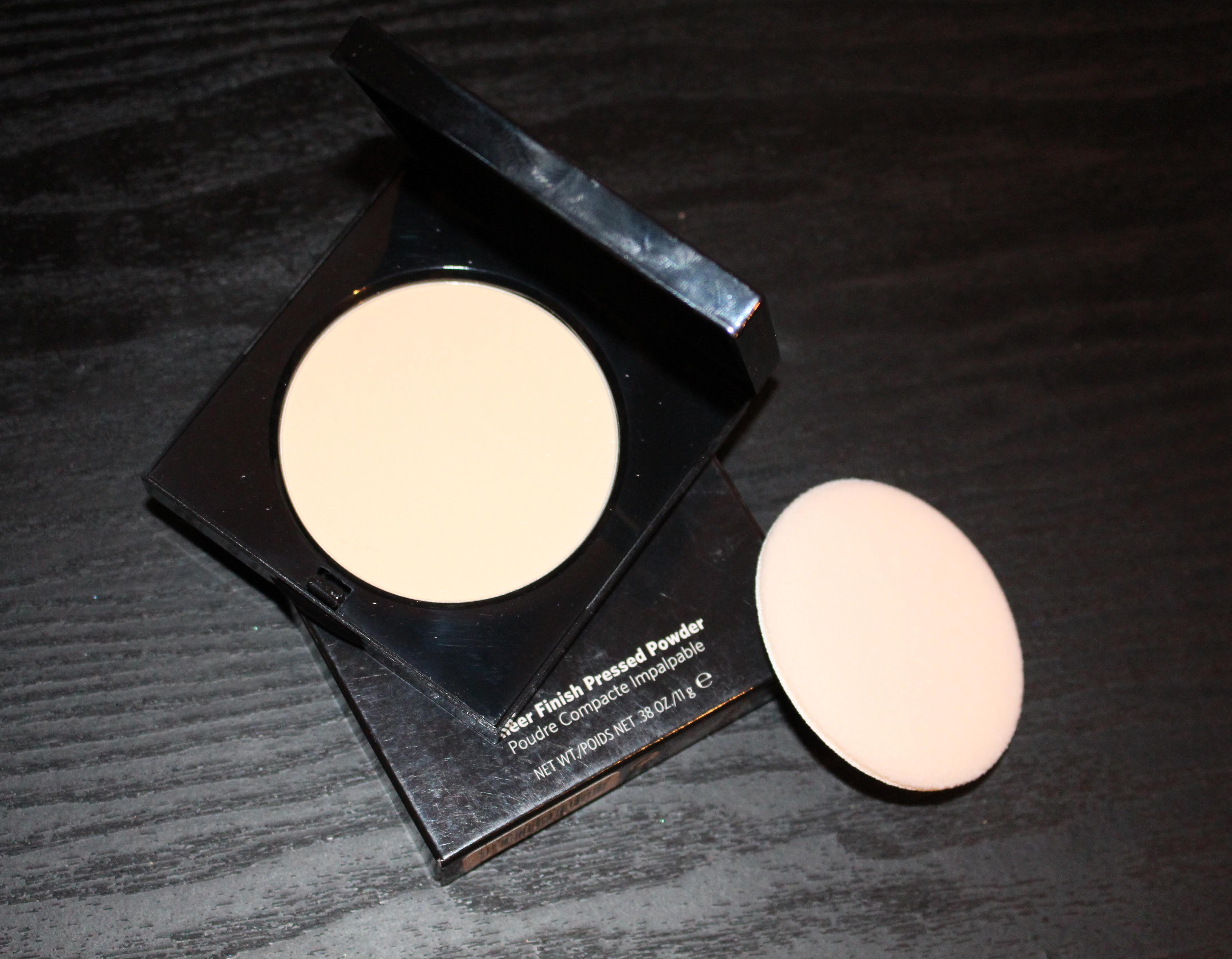 Bobbi Brown sheer finish pressed powder come in a solid, sturdy sleek black compact with sharp corners . .  beware!