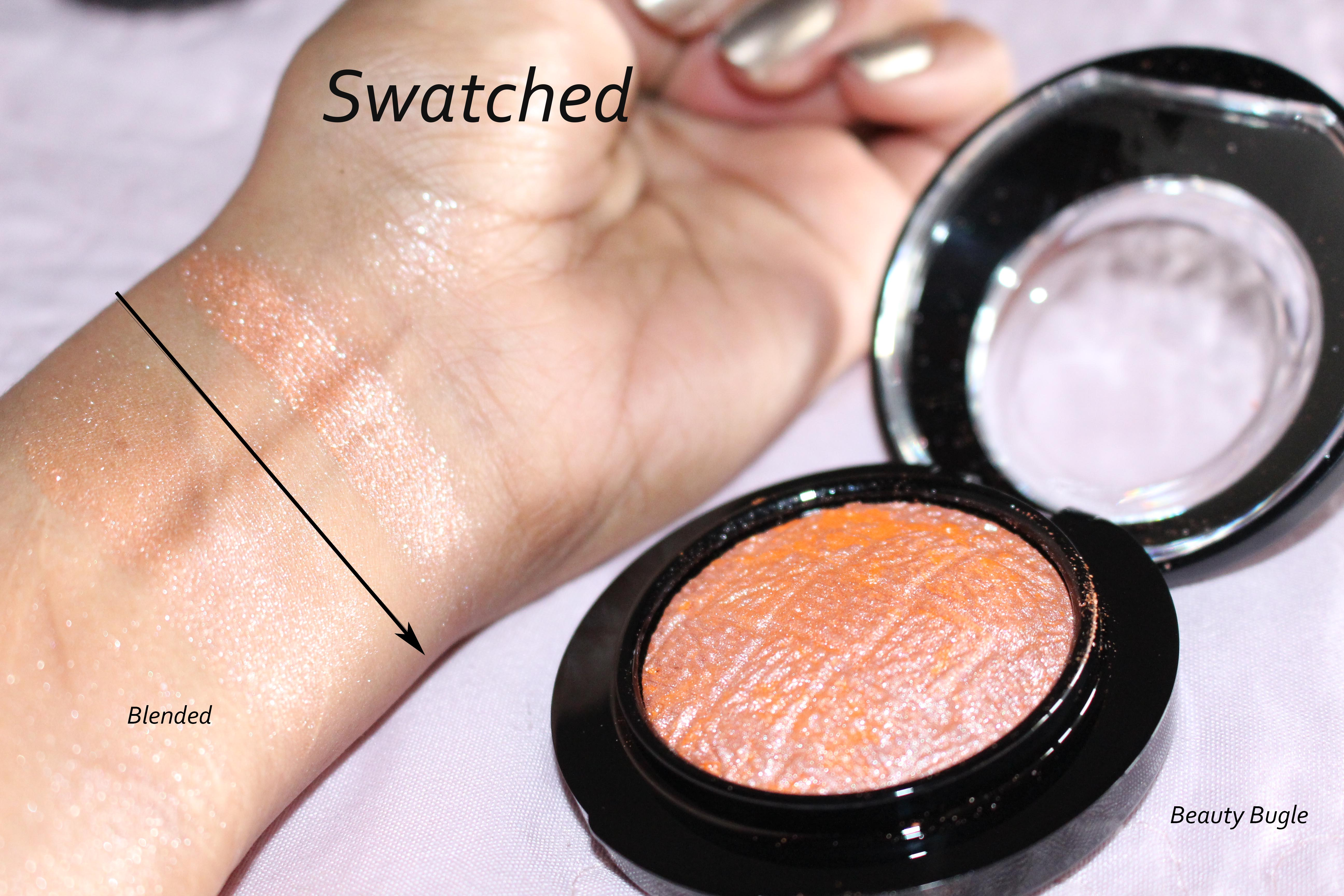 MAC Mineralize Blush in Uplifting swatched. As you can see when watched it is very pigments . Blended it sheers out to a more muted shade that is very unique but the silver sparkles is overwhelming.