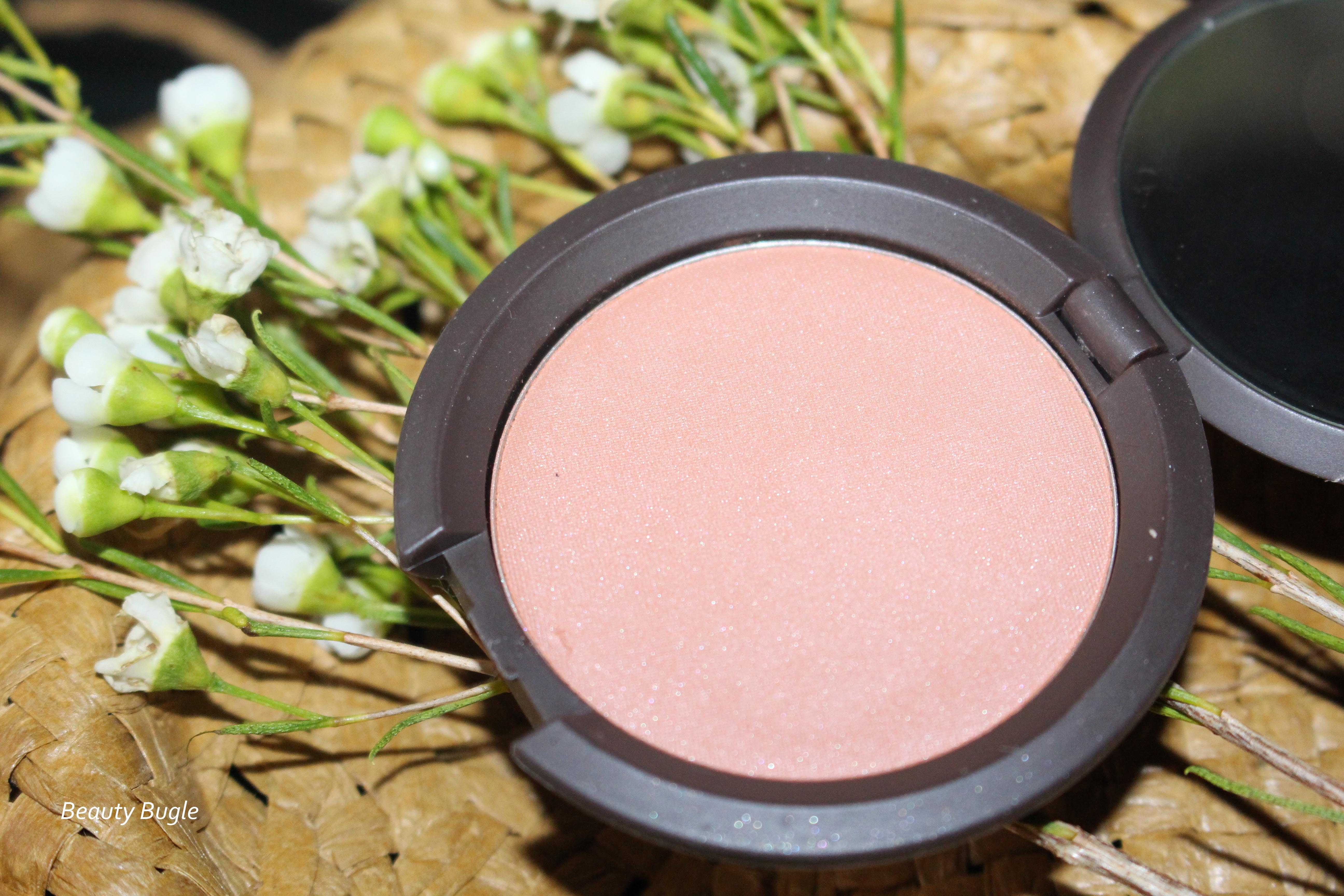 Becca Mineral Blush (Wild Honey) comes in a mirrored compact, not that you can see much in the teeny tiny mirror!