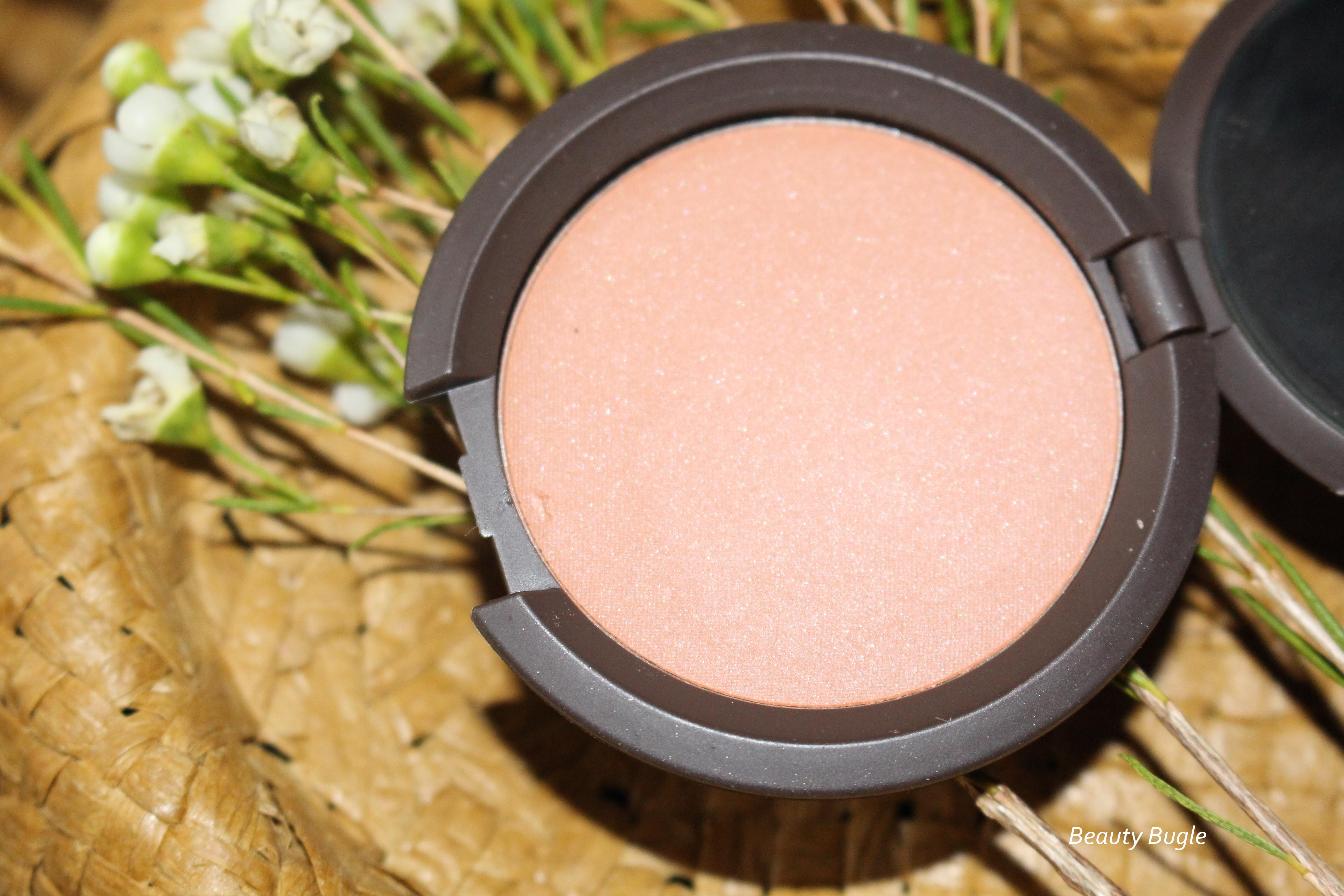 Becca's Mineral Blush in Wild Honey looks like a bronzy peach shade in the pan.