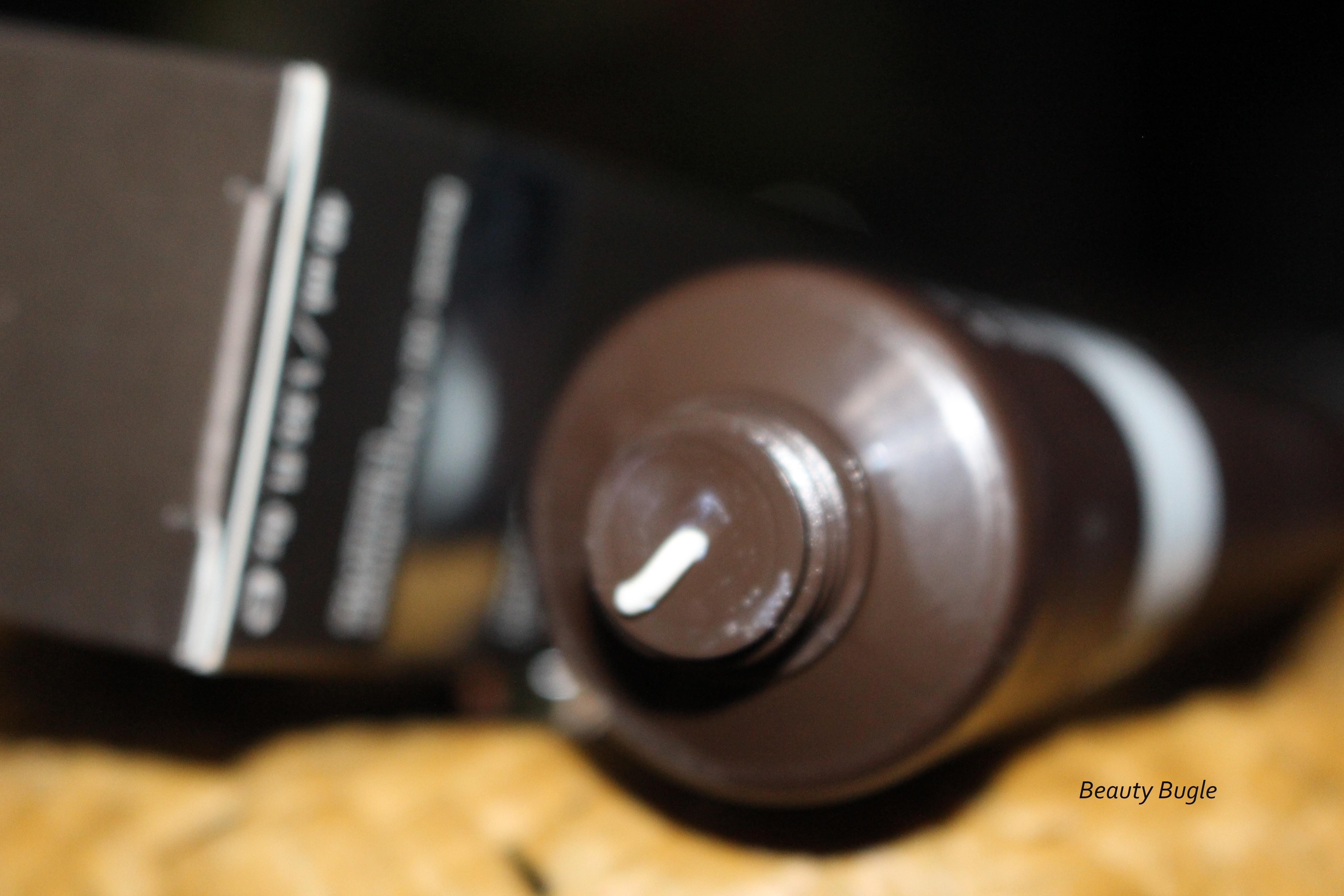 Becca's Resurfacing Primer Perfector™ squeezed out of the tube is thick and white.