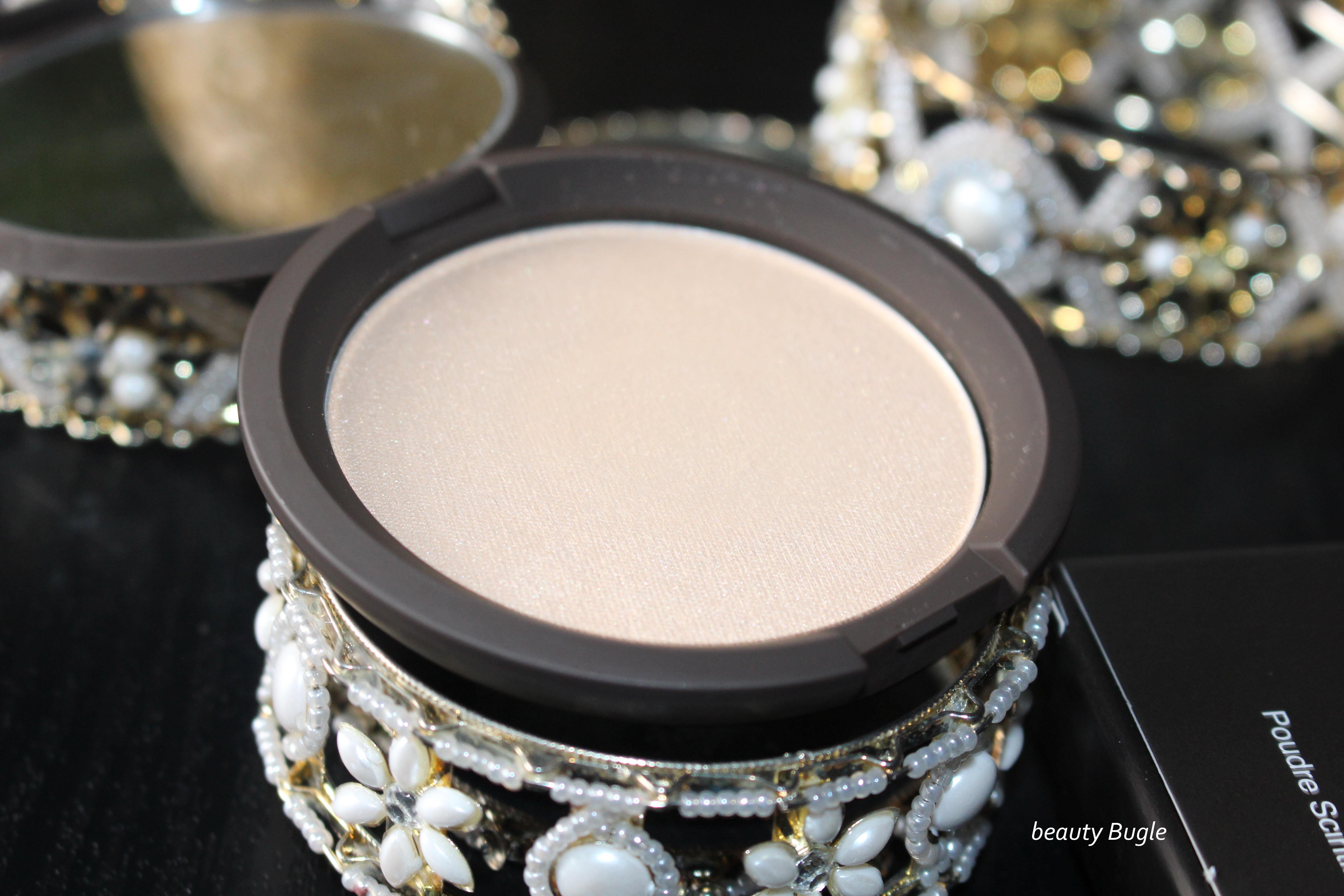 Becca's Shimmering Skin Perfector Pressed (Moonstone) is housed in a mirrored compact.